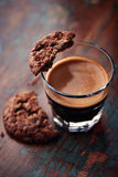 Glass of espresso with chocolate cookie Royalty Free Stock Photos