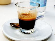 Glass of espresso. Glass of Italian espresso. Photo took in Trani stock photo