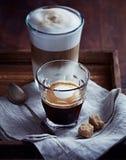 Glass of Espresso Macchiato and Latte Macchiato with Brown Sugar Stock Images
