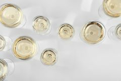 Glass of expensive white wine on light background. Top view Royalty Free Stock Photos