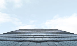 Office Building. Glass Facade on Cloud Background Royalty Free Stock Image