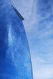 Glass facade. Reflecting a dramatic blue sky Stock Photos
