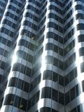 Glass facade. Wave form facade reflects the sun royalty free stock photography