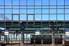 Glass facade building with mirrored windows Stock Images