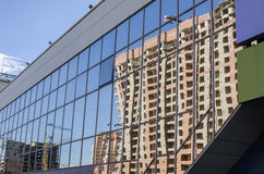Glass facade of building with reflection of building Stock Images