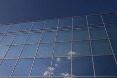Glass facade - corporate building. Blue sky royalty free stock photo