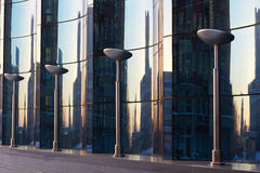 The glass facade of curved blue glass Stock Photos