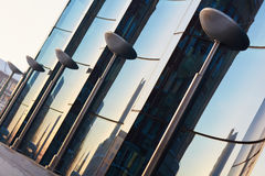 The glass facade of curved blue glass Royalty Free Stock Images