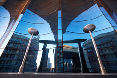 The glass facade of curved blue glass Stock Images
