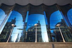 The glass facade of curved blue glass. Royalty Free Stock Images