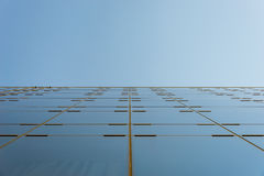 Glass facade that leads to the sky Royalty Free Stock Images