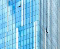 Glass facade of modern building. Cloudy sky reflects in glass Royalty Free Stock Images