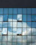 Glass facade of modern office building with open windows Stock Image