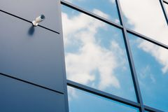 Glass facade of modern office building. With security camera royalty free stock photography