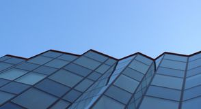 Glass facade of office building. Heavenly background. Blue tone. stock photo