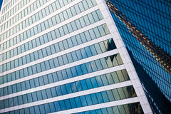 Glass facade of office building on a sunny day with reflection of skyscrapers. Glass facade of office building on a sunny day with reflection of skyscrapers royalty free stock photography