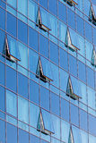 Glass facade with opened windows Stock Image