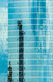 Glass Facade with Reflection of Abstract Building. Background Royalty Free Stock Images