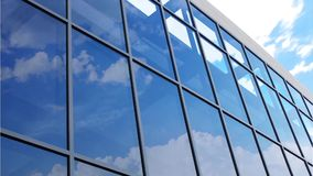 Glass facade with reflection of clouds stock footage