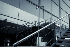 Glass facade with reflection and handrail Royalty Free Stock Photos