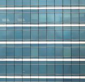 The glass facade of skyscraper stock photography