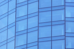 The glass facade of a skyscraper with a mirror reflection of sky windows. Photo Stock Photography