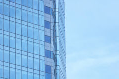 The glass facade of a skyscraper with a mirror reflection of sky windows Royalty Free Stock Photos