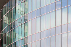 The glass facade of a skyscraper with a mirror reflection of sky windows Royalty Free Stock Images