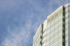 The glass facade of a skyscraper with a mirror reflection of sky windows Royalty Free Stock Photo