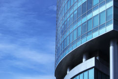 The glass facade of a skyscraper with a mirror reflection of sky windows. Photo Royalty Free Stock Images