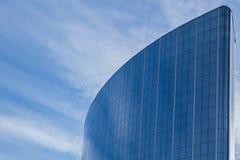 The glass facade of a skyscraper with a mirror reflection of sky windows. Photo Stock Photo