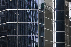 Glass facade of skyscraper in new york downtown manhattan with a Royalty Free Stock Image