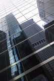 Glass facade of skyscraper in new york downtown manhattan with r Royalty Free Stock Photos
