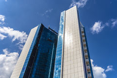 Glass facade of a tall building in the background of the sky Stock Photo