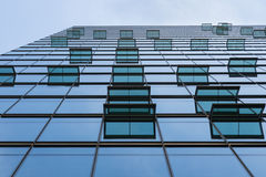 Glass facade with windows of modern building Stock Photo