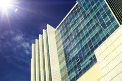 Glass facades of a skyscraper in a bright sunny day with sunbeam Stock Photography