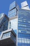 The glass facades of skyscrapers Stock Photos