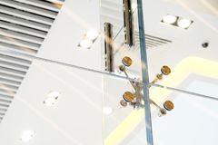 Glass facades and walls. Metal fasteners. Selective focus.  stock photos