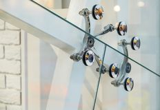 Glass facades and walls. Metal fasteners. stock image