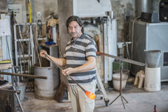 At the glass factory in Murano. The Pictures are shot in the period of May 17-24, 2014 during a weeklong vacation trip to Venice and shows one glassblower who Stock Photography