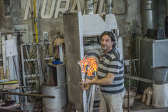 At the glass factory in Murano. The Pictures are shot in the period of May 17-24, 2014 during a weeklong vacation trip to Venice and shows one glassblower who Stock Photos