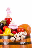 Glass and fall vegetables on barrel Royalty Free Stock Image