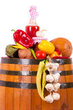 Glass and fall vegetables on barrel Stock Images