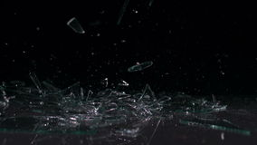 Glass falling and smashing into pieces stock video