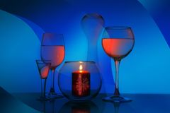 Glass fantasy with glasses and a candle royalty free stock photography