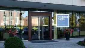 Glass fasad av en modern kontorsbyggnad med Goldman Sachs Group Redaktörs- tolkning 3D Royaltyfri Bild