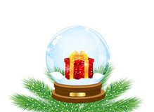 Glass festive ball with a gift inwardly Royalty Free Stock Photos