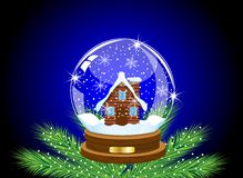 Glass festive ball with a house inwardly Royalty Free Stock Photos