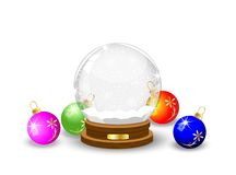 Glass festive ball and varicoloured marbles Royalty Free Stock Photo
