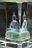 Glass figure of a seated Buddha Stock Photos